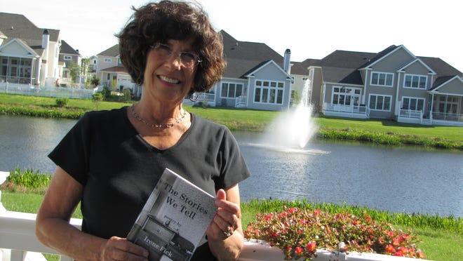 """Irene Fick of Lewes holds a copy of her poetry chapbook, """"The Stories We Tell,"""" which recently received a first place award in the 2015 National Federation of Press Women communications contest for poetry books."""
