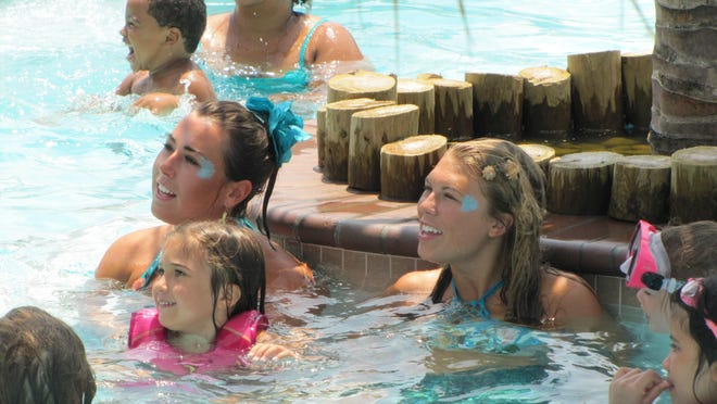 Mermaids Rylie Doyle and Claire Esham pose for a photo Tuesday, July 7, at the Francis Scott Key Family Resort near Ocean City.