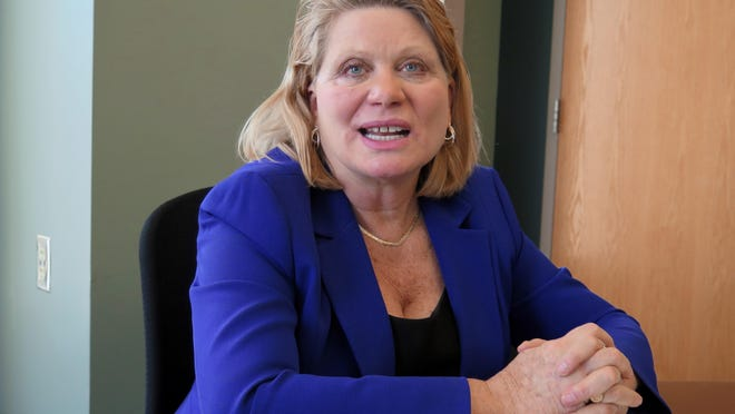 """Secretary of State Ruth Johnson talks during an interview on Wednesday at her office in Lansing, Mich. Johnson said it is """"imperative"""" that voters be able to cast an absentee ballot for any reason now that the straight-party voting option has been eliminated from ballots."""