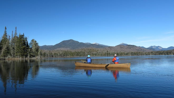 Connie Prickett, right, of The Nature Conservancy, takes a guest on a canoe tour of Boreas Pond in North Hudson.
