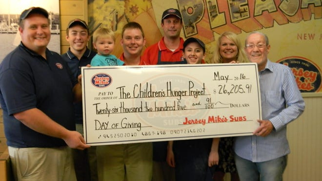 Jersey Mike's recently presented a check for more than $26,000 to the Children's Hunger Project. With the money, the all-volunteer charity will be able to feed 172 malnourished local kids on weekends during the upcoming school year. From left are Tyler Freese, Trevor Murphy, William Price, Bryan Price, Harrison Freese, Kara Blue, Nadine Smith and Bob Barnes.