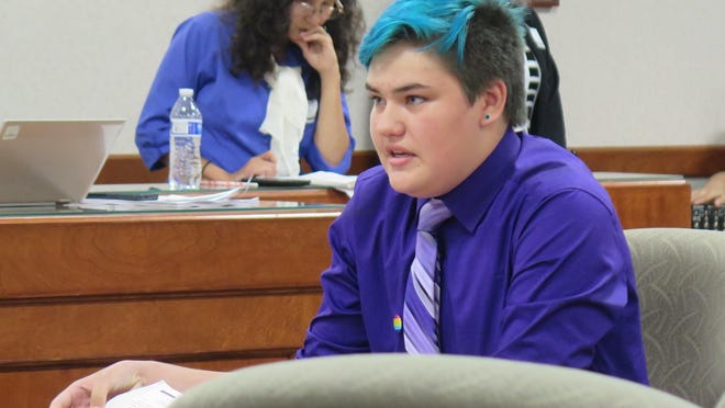 """Shane Shananaquet, a transgender tenth-grader from Adrian, Mich., urges the State Board of Education to approve LGBT guidelines for schools at the board's meeting on Wednesday, Sept. 14, 2016, in Lansing, Mich. Shananaquet said his school district is accommodating, but transgender students in other districts """"suffer"""" and """"hide themselves."""""""