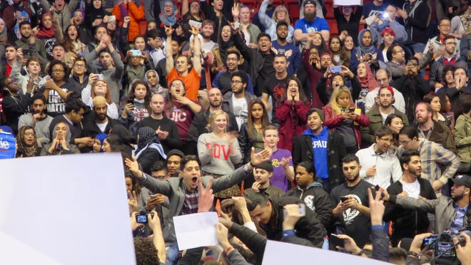 People celebrate after the Donald Trump campaign rally at the University of Illinois at Chicago was cancelled on Friday, March 11.