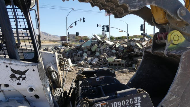A work crew on Monday, July 27, 2020, razed the buildings that once housed the iconic Waffle Iron Cafe and June Market on the corner of Bear Valley and Central roads in Apple Valley.