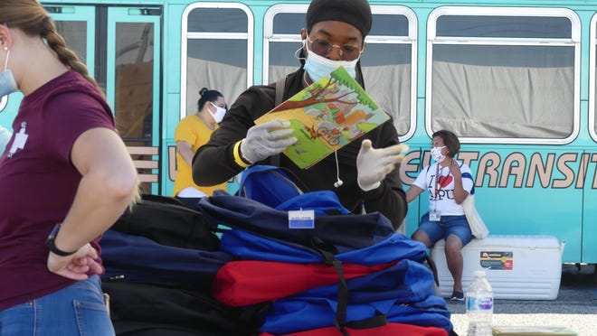 "Samuel N'Gotta joined neary 100 volunteers at the annual back-to-school ""Backpack Giveaway"" event held Thursday, July 30, 2020, at the SBC Fairgrounds in Victorville."
