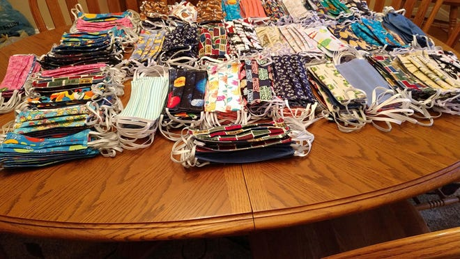 These masks comprise the final collection of masks made by Fairfield Harbour residents and donated to CarolinaEast Medical Center. Shown here are 360 adult masks and 110 child-sized masks. They are part of the 1416 total masks made by Fairfield Harbour residents for CarolinaEast.