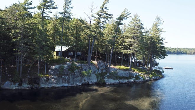 Gillis Realty is marketing this 1,600-square-foot, 5-bedroom residence on Tupper Lake for $600,000. Property taxes on this 5-acre property are $12,300 per year.