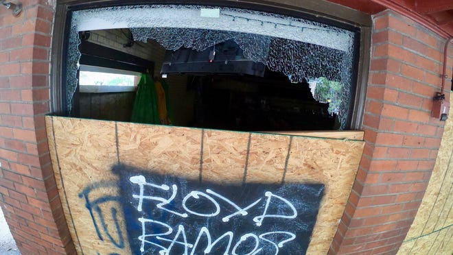 A broken window is seen at a boarded-up bar on Sixth Street on May 31, the morning after Black Lives Matter protests in Austin.
