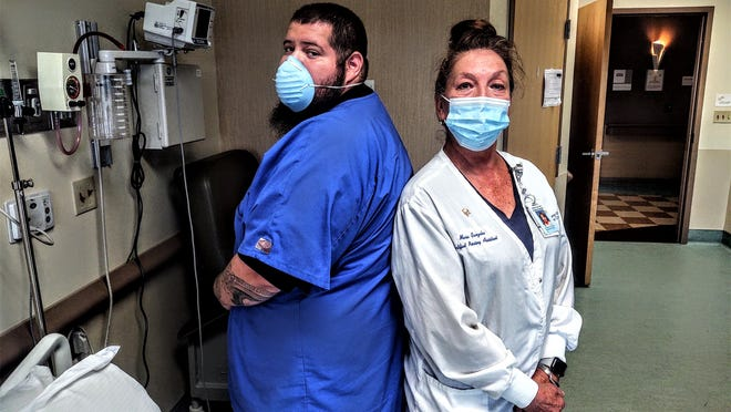 Certified nursing assistants Joseph Marquez, left, and Maria Gonzales, believe the pandemic has increased awareness of the entire healthcare provider network.
