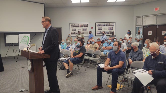 James Bertakis speaks during a meeting of the Sherman Planning and Zoning Commission regarding a proposed 85-lot manufactured home development. The project was denied by the commission following concerns by residents and neighboring property owners.