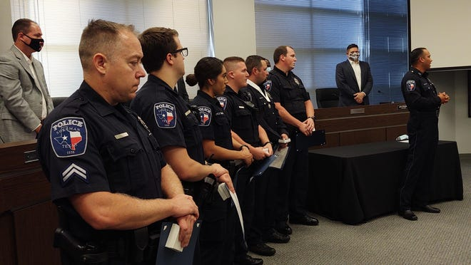 Seven Sherman Police officers were recognized for their efforts in saving the life of a juvenile during a stabbing in late June.