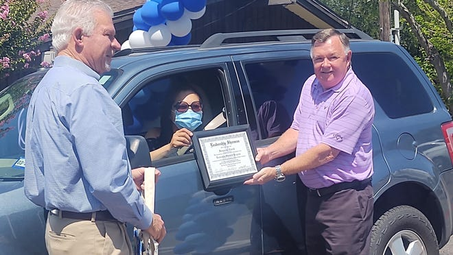 Representatives for the Sherman Chamber of Commerce handout diplomas to Leadership Sherman's 39th graduating class. This year's classes were cut short due to the COVID-19 pandemic and its annual graduation dinner was converted into a drive-thru ceremony as a precaution.