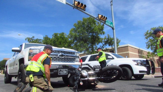 Brownwood police and firefighters are pictured at the scene of a truck-motorcycle accident Wednesday afternoon at the intersection of Fisk and Austin. No one was injured in the rear-end collision.