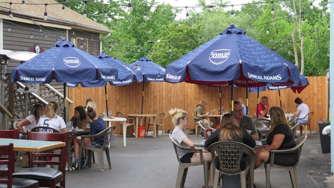 Diners enjoy Lilac City Grille's new outdoor dining space on an overcast Wednesday in Rochester. The space was previously an underutilized alley. It's one the success stories cited by restaurant owners who are lobbying the city to continue outdoor dining once the COVID-19 pandemic is over.