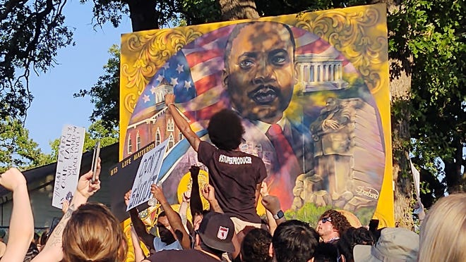 Crowds of protestors gather in Martin Luther King Jr. Park in Denison. Several hundred people marched through Denison Wednesday night following death of George Floyd while in police custody in Minneapolis, Minnesota in late May.