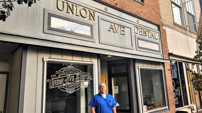 Dr. Anthony Knowlton in front of his Union Ave. Dental building at 317 South Union Avenue.
