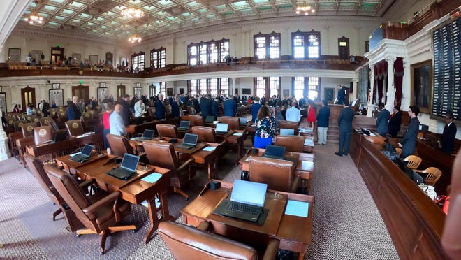 Desks are crowded together in theTexas House chamber in May 2019. House members are trying to figure out where they'll meet when the 2021 session begins in January.