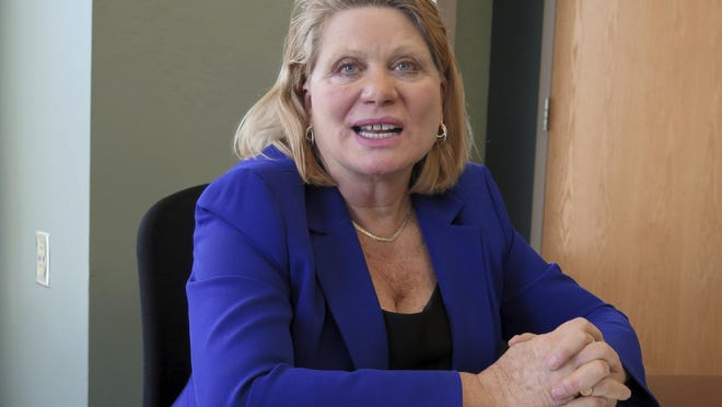 In this Jan. 6, 2016 file photo, then Secretary of State Ruth Johnson, talks during an interview at her office in Lansing, Mich. A bill sponsored by now Republican Sen. Ruth Johnson, would allow Michigan clerks to start processing absentee ballots before Election Day.