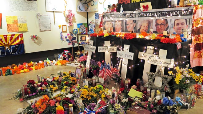 Flowers, teddy bears and inspirational posters line a room at the Arizona History Museum in Tucson in this Wednesday, Jan. 7, 2015 photo. The items were left at the scene of the Jan. 8, 2011 shooting in Tucson that left six dead and 13 wounded. Former Rep. Gabby Giffords was the target and suffered a gunshot wound to the head from which she is still recovering. So many items were left at the shooting site and at University Medical Center, where victims were treated, that a non-profit group stored them in a warehouse for several years. They have been at display at an exhibit at the museum since October, 2014, but will be removed Friday, Jan. 8. (AP Photo/Astrid Galván)