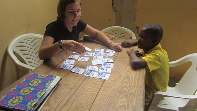 Peace Corps worker Susan Stine of Merchantville helps students with literacy in the rural village of El Coyote on the Samana Peninsula, Dominican Republic, where she has helped raise funds for the first library now under construction.