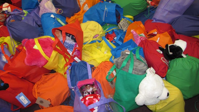 The Pooky Pouches are filled with stuffed animals, blankets and pacifiers for infants and toddlers, and hygiene items and books or journals for older children who are entering emergency foster care.