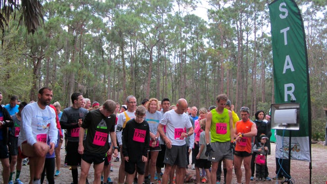 Runners get ready to start last year's Fort Myers annual Calusa Bug Chase 5K run and BUG Crawl.