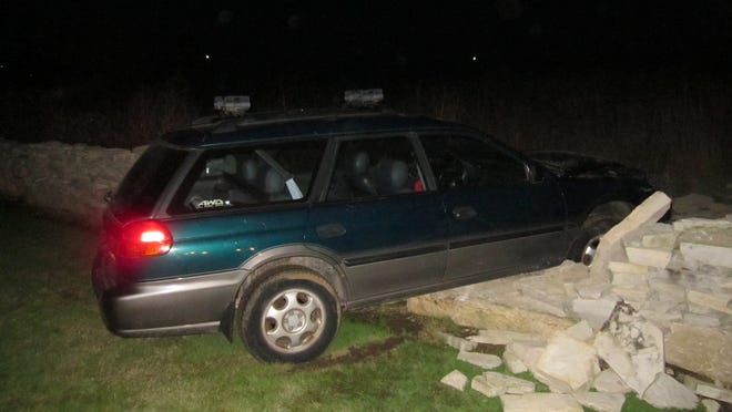 This car missed the curve on Horseshoe Bay Road and went partially through the stone fence owned by the Horseshoe Bay Golf course about 2 a.m. Tuesday. Photo by Door County Sheriff's Department