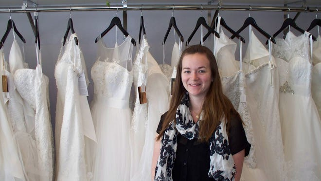 """Jessica """"Jessa"""" Attere poses inside Brides by Jessa at 920 E. Second Ave., Suite 120, in the Iowa River Landing in Coralville."""