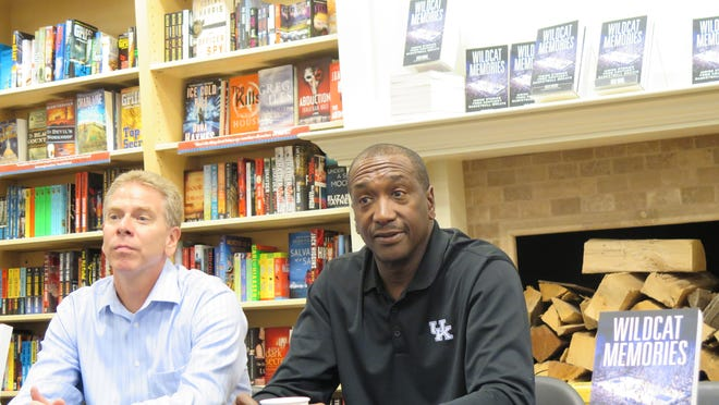 """Doug Brunk, author of """"Wildcat Memories,'' and Jack """"Goose'' Givens, hero of Kentucky's 1978 NCAA title game victory over Duke, at book signing in Crestview Hills, Kentucky."""