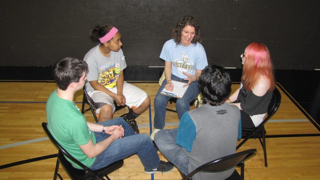 Cape Henlopen High School teacher Amie King leads a discussion with freshman Paige Cully, sophomore Alejandro Madero, sophomore Ryan Wisely and freshman Keila Saez during a Rachel's Challenge breakout session.