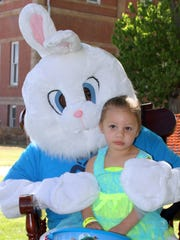 Three-year-old Guadalupe Garcia spent some quality time with the Easter Bunny on Saturday during the fifth annual Community Easter Egg Hunt.
