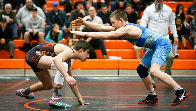 Silverton's Kaden Kuenzi ducks under the arms of Oleh Haider from Ukraine in a match at Sprague High School on Tuesday, March 8, 2017. Kuenzi was the only Salem all-star athlete to win their match against the Ukrainian team; he said his previous experience with freestyle wrestling helped him in the match up.
