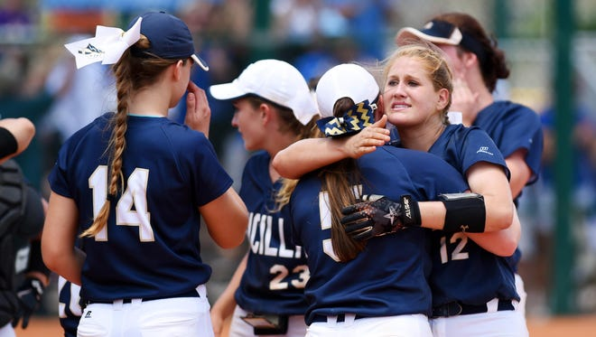 Aucilla Christian's Kaylie Rogers (12) hugs Ramsey Sullivan (5) after a 2-1 loss in nine innings in the state title game against Canterbury, Thursday, May 18, 2017, during the FHSAA Class 2A state championship at Historic Dodgertown in Vero Beach.