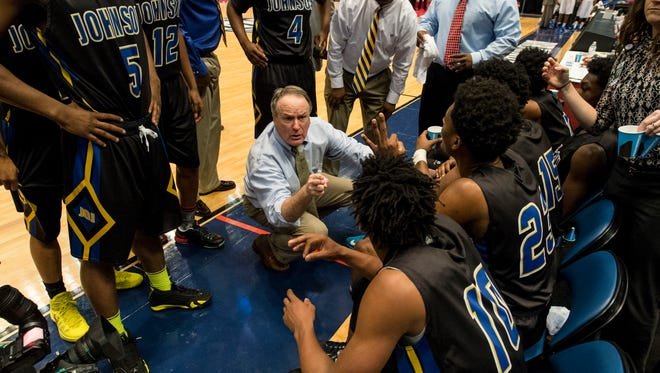 J.O. Johnson coach Jack Doss quizzes his players on time-outs remaining in a late-game break against Ramsay in the AHSAA Class 5A championship boys' high school basketball game in Birmingham, Ala., Saturday, Feb. 28, 2015. (AP Photo/AL.com, Vasha Hunt) MAGS OUT