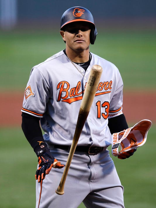 Baltimore Orioles' Manny Machado flips his bat after striking out to Boston Red Sox starting pitcher Drew Pomeranz during the first inning of a baseball game at Fenway Park in Boston, Wednesday, May 3, 2017. (AP Photo/Charles Krupa)