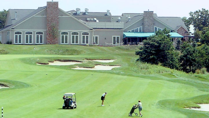 The clubhouse overlooking the 18th hole at Eagle Ridge