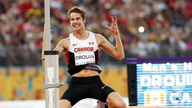Derek Drouin of Canada reacts in the men's athletics high jump final during the 2015 Pan Am Games at CIBC Pan Am Athletics Stadium.