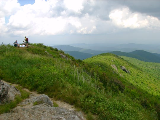 Hikers take a break near the peak of Tennent Mountain along the Art Loeb Trail. The Art Loeb Trail takes hikers over two 6,000-foot peaks and into the expansive Shining Rock Wilderness in Pisgah National Forest.