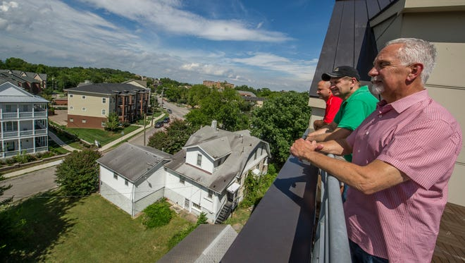 Tom McCormick, right,  and his partners Terry Coker and Dusty Hannah look over the neighborhood from the roof of Mezzo West End, a new condo not far from Maggiano's Little Italy restaurant in Nashville.