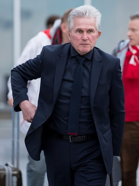 Munich's  head coach Jupp Heynckes  walks to the gate prior to the departure of FC Bayern Munich soccer club, at the airport in Munich, Germany, Monday, April 2, 2018. FC Sevilla of Spain will face FC Bayer Munich  in a Champions League quarterfinal first leg match on Tuesday. (Sven Hoppe/dpa via AP)