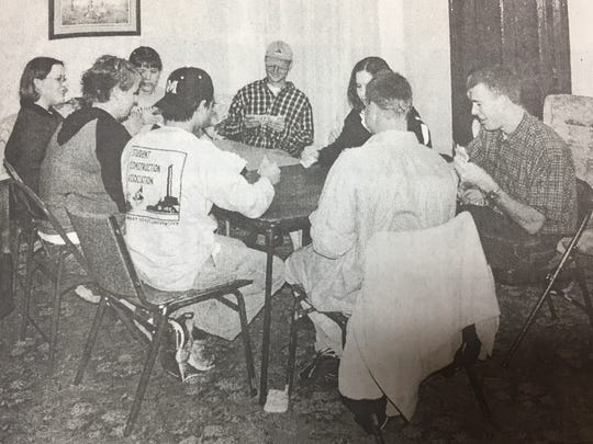Shown here, a group of young adults enjoyed a card game at the opening of the New Connection Coffeehouse in Sturgis in March 2002.