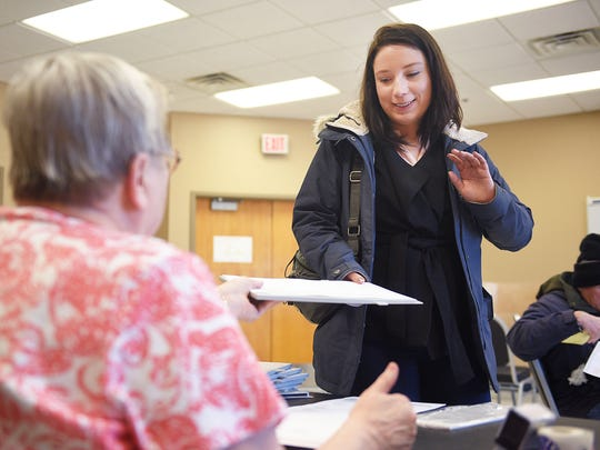 Alma Sehovic takes her ballot to vote in the Mayoral and City Council elections, Tuesday, April 10, at the Oyate Community Center in Sioux Falls.