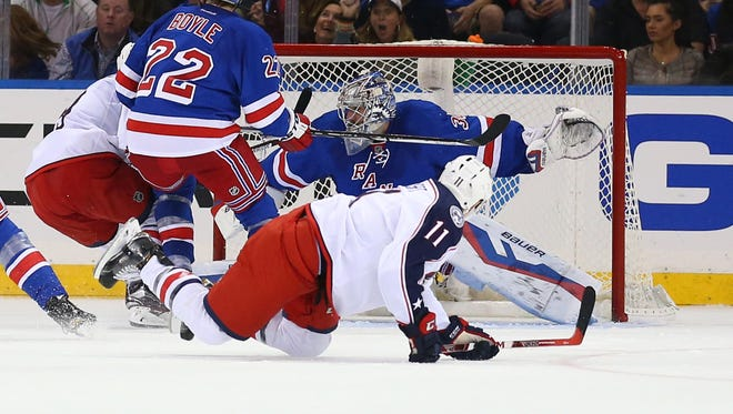 New York Rangers goalie Henrik Lundqvist (30) works for a save during the second period against the Columbus Blue Jackets at Madison Square Garden.