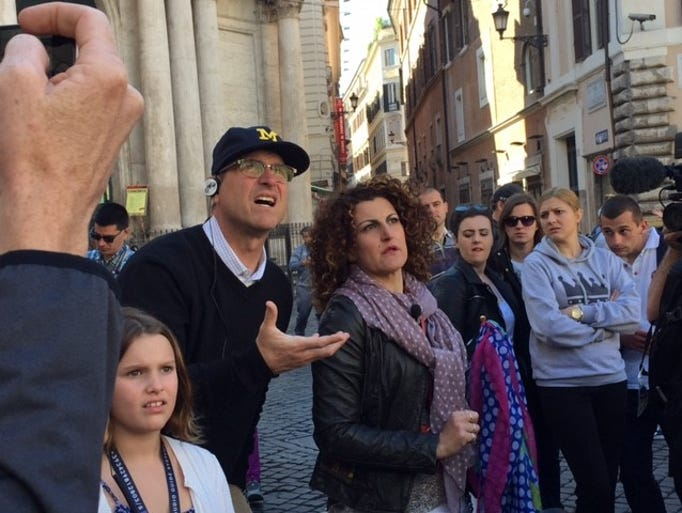 Jim Harbaugh makes a wish at the Trevi Fountain --