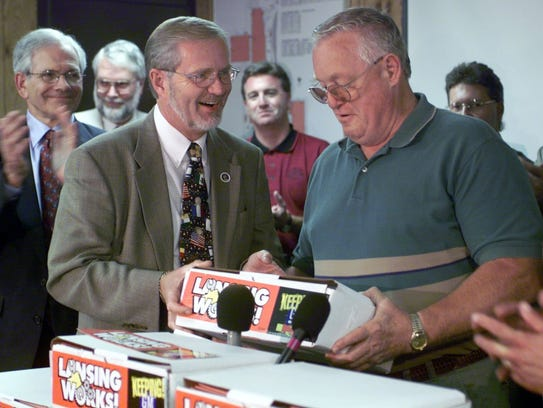 In a 1999 image, then-Mayor David Hollister gives UAW