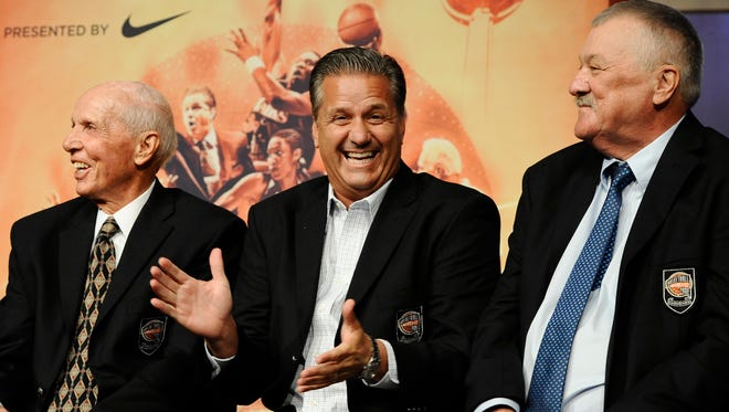 The 2015 class of inductee John Calipari, center, reacts as fellow inductees Dick Bavetta, left, and Louis Dampier, right, listen, during a news conference at the Naismith Memorial Basketball Hall of Fame,Thursday, Sept. 10, 2015, in Springfield, Mass.