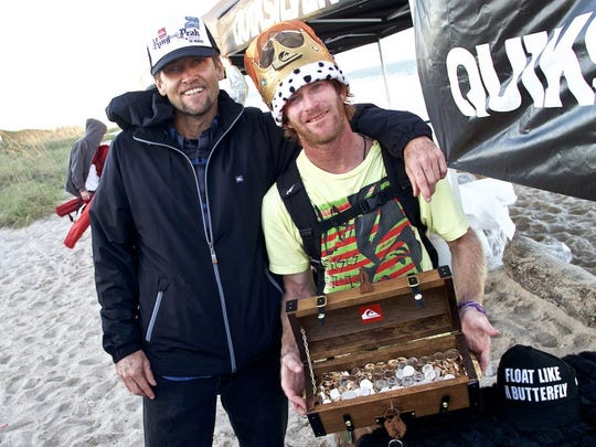 Aaron Cormican and Matt Kechle hold the treasure chest