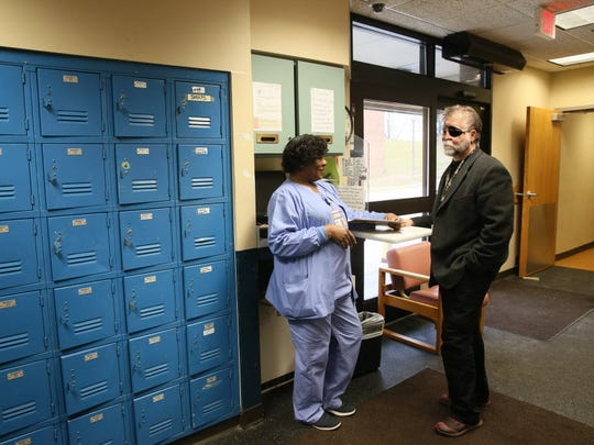 Floria Hill (left), a nurse at the Mental Health Complex in Wauwatosa, speaks with John Schneider, chief medical officer of the Behavioral Health Division.