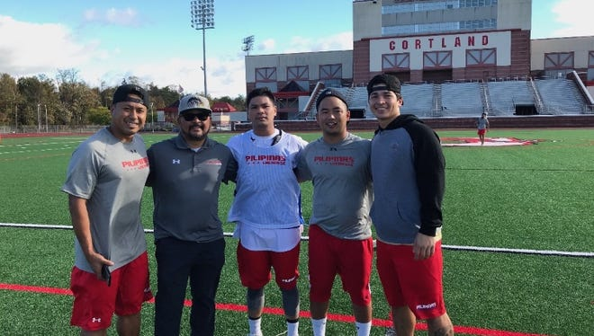 James Schutt (far left) stands with members of the Filipino national lacrosse team.