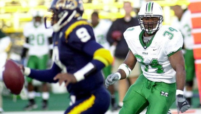 Ralph Street (34) played defensive end at Marshall and chases down Kent State's Josh Cribbs. He now serves as defensive coordinator at FAMU.